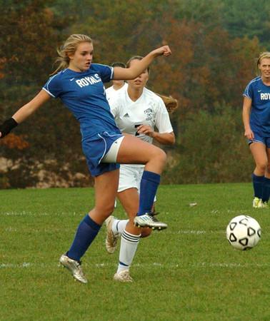 Byfield: Georgetown's Jenseena Moner kicks the ball past Triton's Bethany Saunders. Bryan Eaton/Staff Photo