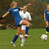 Byfield: Georgetown's Jenseena Moner kicks the ball past Triton's Bethany Saunders. Bryan Eaton/Staff Photo