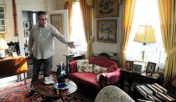 Newbury: Auctioneer John McInnis describes some of the furniture in the Lunt sisters' home. Bryan Eaton/Staff Photo