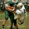 West Newbury: Pentucket's Tim Freiermuth runs for yards taking two WInthrop defenders with him. Bryan Eaton/Staff Photo