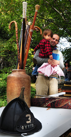 Newbury: Travis Sumner, of Newburyport brought his daughter, Lila, 2, to check out some items before the auction of the Lunt estate. Bryan Eaton/Staff Photo