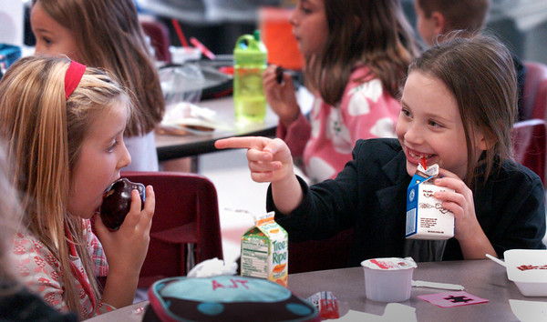 Newbury: Amelia Noyes, right, points out a friend at the next table to Amelia Tardy, both 7, during lunch at Newbury Elementary School on Tuesday. It was Mix It Up at Lunch Day wheres students were assigned seats to sit with different students instead of their usual friends. The national campaign was introduced a decade ago by Teaching Tolerance that encourages them to sit with someone new at lunch to identify, question and cross social boundaries. The exercise is aimed at fostering respect and understanding at schools and encouraging school spirit and unity and helping students different kinds of people. Bryan Eaton/Staff Photo