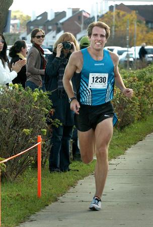 Newburyport: Nate Jenkins of Andover comes over the finish in the Greenstride Half Marathon. Bryan Eaton/Staff Photo