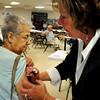 Salisbury: Public health nurse Cathy Vichill gives a flu shot to Gena Mical of Salisbury at the Hilton Center on Monday morning. Bryan Eaton/Staff Photo