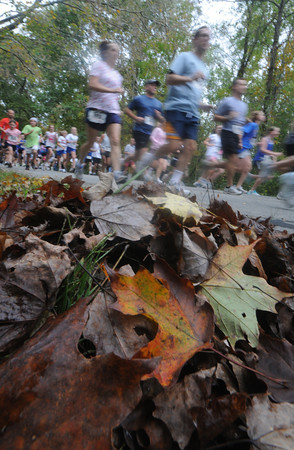 West Newbury: Runner take off at the start of the 22nd Annual Apple Harvest Run in West Newbury Sunday afternoon. Jim Vaiknoras/Staff photo