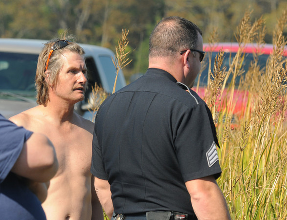 Newbury: James Waldrip talks with Newburyport police sargent  Steve Chaisson after Waldrip drove his pickup truck into the Parker River in Nebury. Jim Vaiknoras/Staff photo