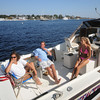Newburyport: Marla Checkoway, Steve DeMaranvile, and Abbey Bergman enjoy a warm afternoon aboard the Satisfaction along the boardwalk in Newburyport Monday. Jim Vaiknoras/Staff photo
