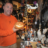 Newburyport: Kevin Riley hold an illuminated jack-o-lantern at his store, A Partrige in a Bear Tree in Downtown Newburyport. Jim Vaiknoras/Staff photo