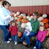 Amesbury: Nadeane LaCroix, left poses her daughters Kayla ,4, Kate ,2 and Claire , 15 months, with her mother in law Pam Benham with pumpkins at Cider Hill Farm in Amesbury Thursday. The family were there to pick apples. Jim Vaiknoras/Staff photo