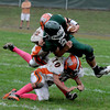 West Newbury: Pentucket's Cody Rothwell is tackled by Patrick Curran and Louis Galanis at home against Ipswich Saturday. JIm Vaiknoras/Staff photo