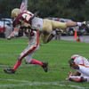 Newburyport: Newburyport's James Comway goes airborn after making a long recieption agaist Ipswich during Saturday's game at Newburyport. Jim Vaiknoras/Staff photo