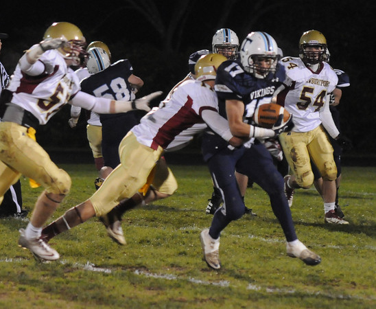 Byfield: Triton's Dominic Rovetto  fights for yardage after a reception at home against Newburyport Friday night. Jim Vaiknoras/Staff photo