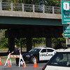 Newburyport: Newburyport police officer Jason Kohan puts up baracades at the on ramp to Rt 1 at Merrimack street in Newburyport Monday morning. Trafic was diverted due to a problem with the Gillis Bridge. Jim Vaiknoras/Staff photo