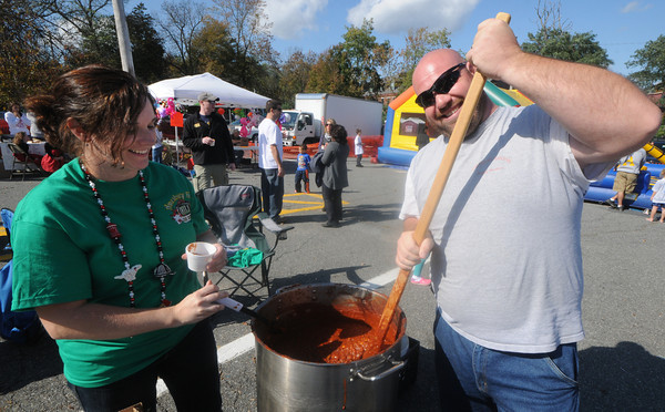 Amesbury: Joe Pratt and Amber McGregor of Amesbury Towing stir their pot at the annual Amesbury Firefighters Chili Cook-off Saturday. Jim Vaiknoras/Staff photo