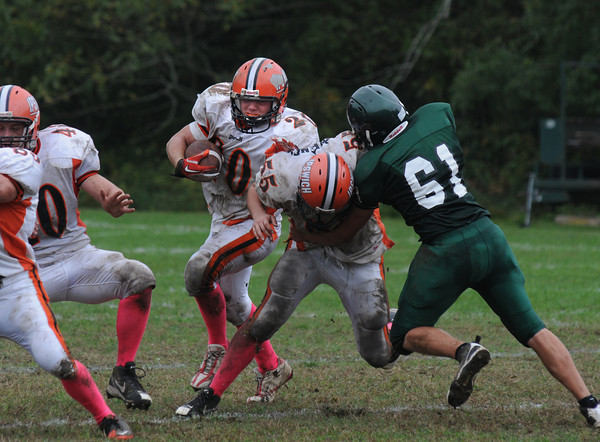 West Newbury:  Ipswich's Peter Moutevelis rus through a hole  at Pentucket Saturday. Saturday. JIm Vaiknoras/Staff photo