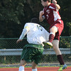 North Reading: Newburyport's Nathan Northey goes up for a header against a North Reading player at North Reading. JIm Vaiknoras/Staff photo
