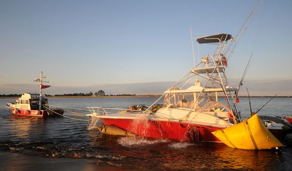 Newburyport: Pumps empty water from the Samantha Mae as it sits along Plum Island Point, the boat sunk off the North Jetti in Salisbury Sunday morning. Jim Vaiknoras/Staff photo