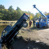 Newbury:A tow truck from Volpone towing pulls a pickup truck out of the Parker River Monday . Jim Vaiknoras/Staff photo