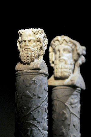 Boston: A pair of herma presents two faces of the God Bacchus, one youthful and the other mature from Pompeii at the new exibit at the Miseum of Science. JIm Vaiknoras/Staff photo