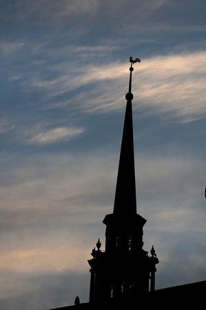 Newburyport: The Unitarian Universalism Church Steeple is backlite by the evening sky in Newburyport. Jim Vaiknoras/Staff photo
