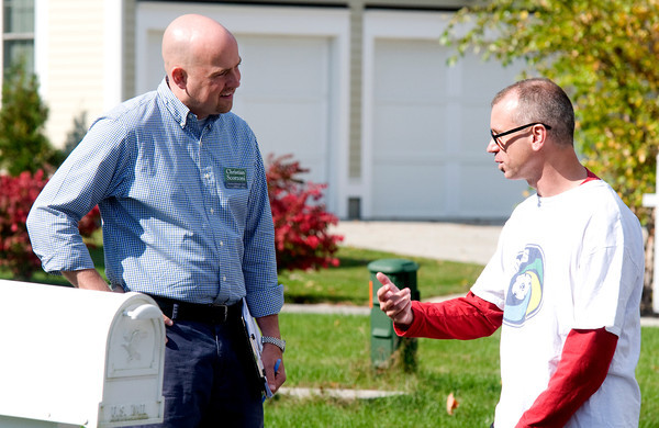 Amesbury: Amesbury City Council candidate Christian Scorzoni talks with Amesbury resident Michael Alaimo on Fairway Drive Saturday. Jim Vaiknoras/Staff photo