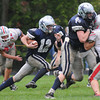 Hamiton: Hamilton-Wenham's Trevor Lyons runs the ball Amesbury during their game at Hamilton Saturday. Jim Vaiknoras/staff photo