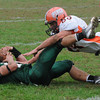 West Newbury: Pentucket's Cody Rothwell cradles the ball as he is hit by Cam Murray at home against Ipswich Saturday. JIm Vaiknoras/Staff photo