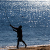 Newbury: A surf caster casts his line off Plum Island Saturday morning. Jim Vaiknoras/Staff photo