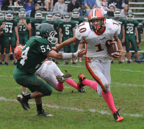 West Newbury:  Ipswich's Louis Galanis stiff arms Mike Tashjian at Pentucket Saturday. Saturday. JIm Vaiknoras/Staff photo