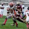 Newburyport: Ipswich's Peter Moutevelis breaks a tackle during Saturday's game at Newburyport. Jim Vaiknoras/Staff photo
