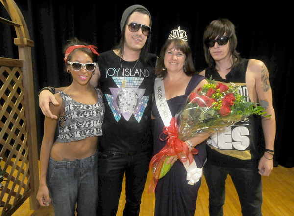 "Topsfield: The newly crowned Mrs Essex County, Belinda Barbas with her son, Johnny Barbas, left and his bandmates Bri Summers, and Josh Bissell after the pageant at the Topsfield Fair Sunday. Johnny, whose band is called Joy Island said"" she's the coolest mom ever"". Jim Vaiknoras/Staff photo"