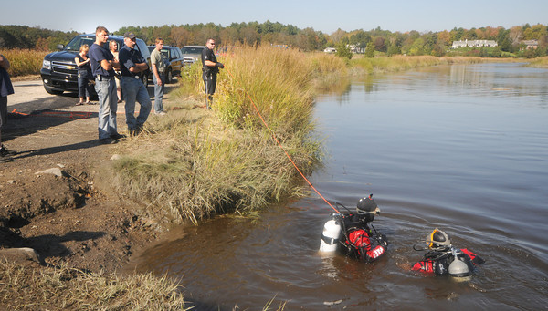 Newbury:Members of the Newburyport dive team search the Parker River of Middle Road in Newbury for a pickup truck that was driven into the river Monday . Jim Vaiknoras/Staff photo