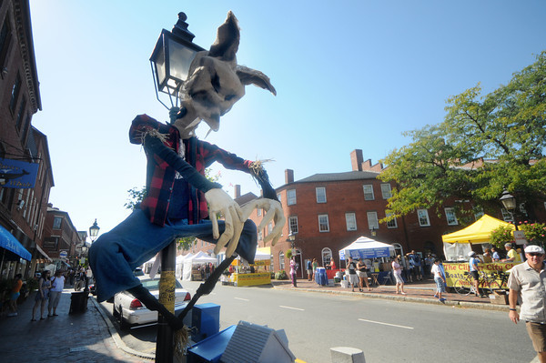 Newburyport: A Big Bad Wolf scarecrow put up by The Theater in the Open guards the corner of State Street and Liberty in Market Square in Newburyport Sunday morning during the annual Harvest  Festival. JIm Vaiknoras/Staff photo