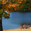 Amesbury: The leaves on this tree at Lake Gardner Beach in Amesbury and the almanac may say it's fall, but the weather yesterday said it was summer. Lesley Stewart, left, and Donna Kadell, both of Newburyport took advantage of the 80-plus temperature to work on their suntans. Bryan Eaton/Staff Photo