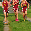 Newburyport: The first Newburyport boys runners come across the finish line together, from left, Chris Supra, Keith Conway and Joe Santo. Bryan Eaton/Staff Photo