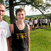 Newburyport: Newburyport High cross country coach Don Hennigar, with captain Keith Conway, is in his 25th year in the program. Bryan Eaton/Staff Photo