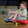 Newburyport: Trevor Landry, 5, moves along on a ExerBug in gym class at the Brown School in Newburyport on Thursday afternoon. The vehicle is propelled by moving the handlebars from side to side. Bryan Eaton/Staff Photo