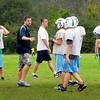 Byfield: Triton head football coach Pat Sheehan works with his team at practice yesterday. Bryan Eaton/Staff Photo