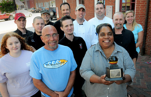 Newburyport: Lisa Cousins of the Thirsty Whale holds her trophy for the Chili Con Carnival that she's won three years in a row. Joining her in the photo are chefs representing the Grog, Purple Onion, Beachcoma, 10 Center Street, Michael's Harborside, Loretta and the Port Tavern who hope to pull home the trophy. Bryan Eaton/Staff Photo