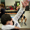 "Amesbury: Sean Rodriguez, 6, sneaks a peek while raising his hand to indicate he had been tapped on the head while his eyes were closed. He and others were playing a game of ""Heads Up Seven Up"" where they try to guess who tapped them at the Amesbury Recreations Department's Afterschool Program at the elementary school Wednesday. Bryan Eaton/Staff Photo"