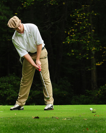 Rowley: Cooper Hines putts on the third hole at Carriage Pines yesterday. Bryan Eaton/Staff Photo