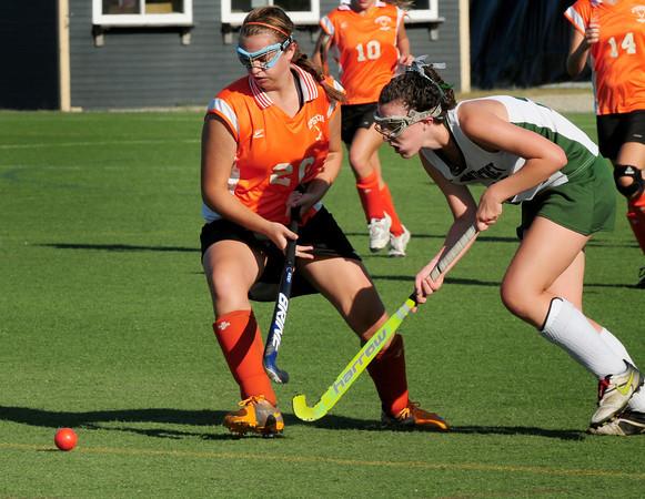 Amesbury: Pentucket's Olivia Duggan has her eye on the ball as she moves past Ipswich's Bridget Curran. Bryan Eaton/Staff Photo