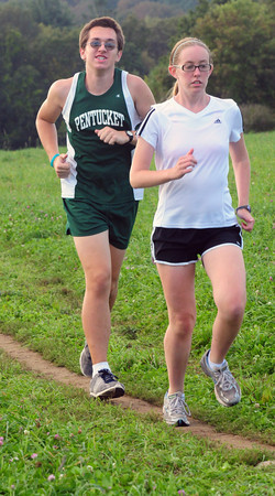 West Newbury: Pentucket cross counrty runner Eric Scott with aide Kacey Hill. Bryan Eaton/Staff Photo
