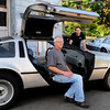 Salisbury: Merry Motors owner Steve Quint, left, and mechanic Chris Detjens with two of the three DeLorean's that they service in the Salisbury shop. Bryan Eaton/Staff Photo
