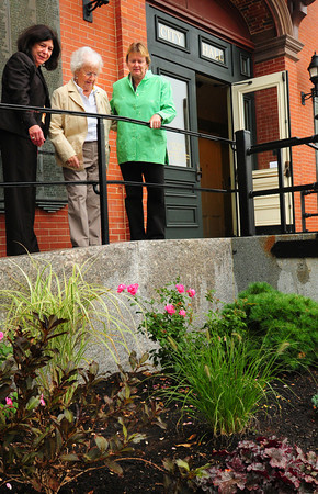 Newburyport: Dottie Phillips, with Newburyport Mayor Donna Holaday, left, and Ghlee Woodworth, right, look at the landscaping outside City Hall that she contributed to. Bryan Eaton/Staff Photo