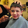 Newburyport: Riley Brown, 6, of Newburyport gets his back-to-school haircut from Esther Sayer at the Inn Street Barbershop in Newburyport on Thursday morning. The first-graders begins the school year Tuesday at the Bresnahan School. Bryan Eaton/Staff Photo
