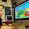 "Amesbury: Kindergartner Bobby Porter, 5, plays the computer game ""Redfish"" in Bruce McBrien's technology class at Amesbury Elementary School on Wednesday. The puzzle game helps young students with their problem solving and critical thinking skills. Bryan Eaton/Staff Photo"