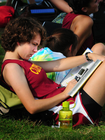 Newburyport: Lindsay Ford, 16, gets some math homework done at Maudslay State Park. The Newburyport High cross country runner was waiting for the opposing team, North Andover, to walk the course. Bryan Eaton/Staff Photo