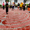 Newburyport: Reverend Martha Hubbard speaks a little about the history of the labyrinth at a dedication and celebration at the YWCA yesterday. Artist Trent Llyod designed the stonework which Hubbard is standing in the middle of. Bryan Eaton/Staff Photo