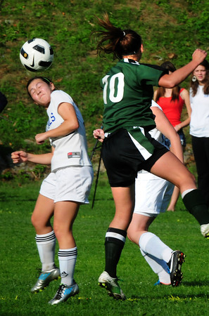 Georgetown: Georgetown's Kelly Chickering, left, and Pentucket's Haley DesRosier try to direct the ball yesterday afternoon at Georgetown. Bryan Eaton/Staff Photo